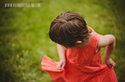 Little Girl Twirling Orange Dress Pixie Hair Cut Outdoors Worcester Massachusetts Portrait Storytelling Photographer Families and Children